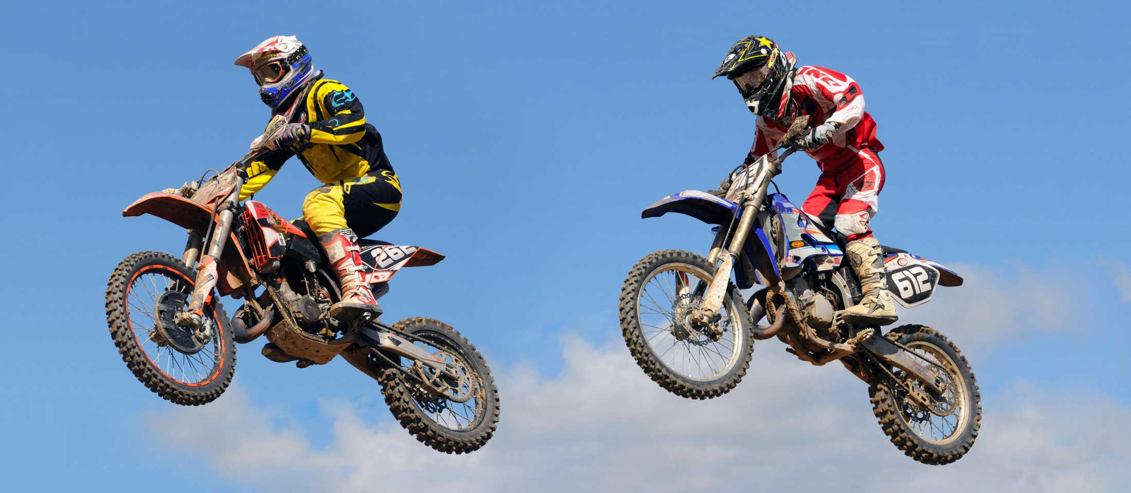 two motocross bikers jumping